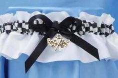 OMG A racing themed garter. MUST HAVE. I'm honestly and really considering this since I love dirt bike racing and Tyler loves car racing I'm digging it :)