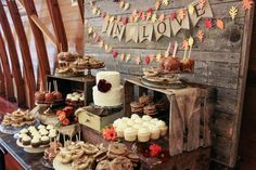 dessert table: I love the small cake here! And the idea of Carmel apples and even pumpkin pie for additional desserts.