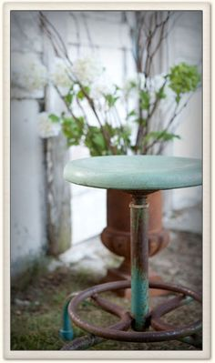 Rusty metal stool lightly painted with Annie Sloan Chalk Paint