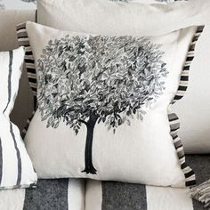 Linnaeus Noir Cushion, embroidered Linen and Silk Mix.  Superbly detailed embroidery in shades of noir and graphite here create this stylish sketched tree design.  This pure decorative cushion comes with a beautiful striped silk reverse and trim