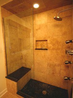 Master Bathroom Shower with pebble stone flooring