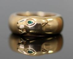 Currently at the #Catawiki auctions: Cartier - 18K Solid Yellow Gold Ring 1996 - With Natural Emerald Gem