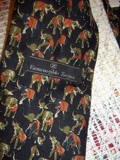 Lot of 2 Ermenegildo Zegna vintage ties, elephants print, hound tooth print Black background with green and khaki elephants Black, white and red hound tooth and lines print Condition: excellent registered mail shipping Hounds Tooth, Elephant Print, Vintage Scarf, Neckties, Elephants, Black Backgrounds, Scarves, Red, Etsy