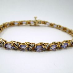 Oval Cut Tanzanite Bracelet with Accent Diamonds. Set in 14K Yellow Gold. $475
