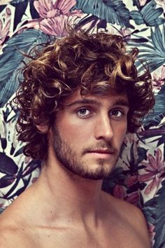When it comes to men hairstyles there is nothing sexier than a man that rocks a curly set of hair. This beach bum look has been in style since back in the 70's and still to this day looks totally awesome.