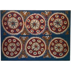 Cotton Kaitag from the Caucasus region, with red and white circular motifs on a blue ground. Mounted.