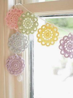 a simple bunting of crochet doilies in pastel shades Crochet Bunting, Crochet Garland, Crochet Curtains, Crochet Motifs, Crochet Decoration, Crochet Doilies, Crochet Flowers, Crochet Patterns, Crocheted Lace