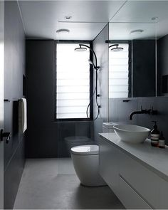 Dark model bathroom. white vanity and stand alone basin. Matte black tap, mixer, towel rack and rainfall shower head. Project by - @couvarasarchitects #taps #interiordesign #bathroom #australia #architecture #bathroomdesign #bathroomcollective Visit our website for more www.bathroomcollective.com.au