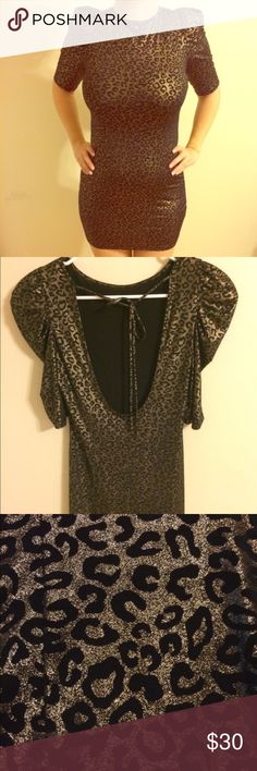 Guess gold leopard print mini dress Guess gold leopard print mini dress. Material is light and thin. Used once. Guess Dresses Mini