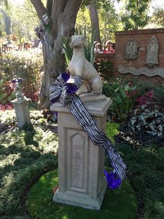 Greetings, mortals. We are your hosts, your graveyard hosts. But seriously, the pet cemetery at the Haunted Mansion is so fun, it's scary (wink wink).