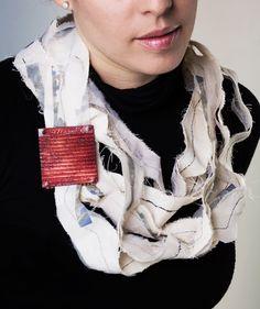 Raquel Bessudo. Necklace: Stories Along the Border, 2013. Cooper, enamel, canvas, cotton textile, image transfer, polyester thread. 3,92 x 6 x .3 cm. Photo: Paolo Gori.