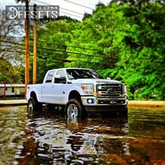 "Ford F350 Super Duty Dually. Lifted & Sittin' On 22"" Rims."