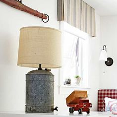 Flea market finds can easily transform into unique farmhouse lighting with the help of a lamp kit, some DIY chutzpah, and a free afternoon. This old galvanized-metal water can, complete with wooden handle, makes a charming addition to a child's bedroom./