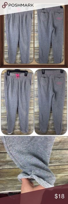 Juicy Couture Girls Gray Sparkly Sweat Pants GUC Girls gray sparkly sweat pants. In good used condition. Size large (14). Pockets in front and the back. 28 inch waist without stretching material. 9 inch rise. 28 inch inseam. Juicy Couture Bottoms Sweatpants & Joggers