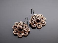 Beautiful, small Soutache earrings, made of Soutache strings with Swarovski pearl, Hematite and glass beads. Colour: shades of beige and brown. Lace Earrings, Soutache Earrings, Earring Trends, Shades Of Beige, Polymer Clay Charms, Silk Ribbon Embroidery, Button Crafts, Swarovski Pearls, Beading Tutorials