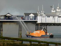 RNLI Lifeboat fire fighting at Eastbourne Pier, Eastbourne, East Sussex, England