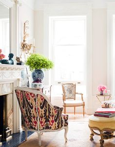 In the sun-filled front area of the living room, the chaise and chair set — or duchesse brisée — is covered in Lee Jofa's Pardah Print in Sable.