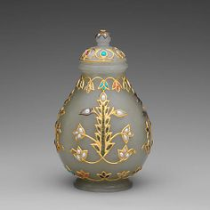 Jar with Cover Period: Mughal period (1526–1858) or Qing dynasty (1644–1911) Date: 18th–19th century Culture: India Medium: Jade (nephrite) inlaid with gold and stone Dimensions: H. 4 3/16 in. (10.7 cm); W. 2 5/8 in. (6.7 cm) Classification: Jade Credit Line: Gift of Heber R. Bishop, 1902