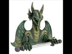 A fierce dragon becomes a helpful valet in the design of the Design Toscano Commode Dragon Bath Tissue Tyrant . Funny Toilet Paper Holder, Recessed Toilet Paper Holder, Toilet Paper Dispenser, Wall Mounted Toilet, Toilet Roll Holder, Gothic Bathroom Decor, Bathroom Wall Decor, Bathroom Ideas, Modern Bathroom