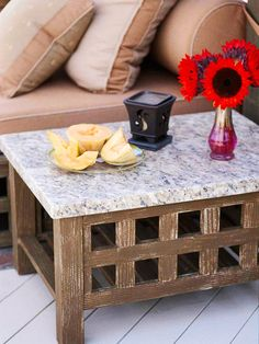 All-Weather Decor  A honed-granite top and a distressed-fir base ensure this side table will weather gracefully. Nearby cushions are weatherproof, too -- the owner simply hoses all the surfaces about once a week.