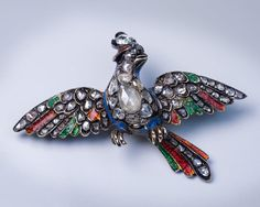"""Georgian brooch, c. 1750. This is a very fine and extremely rare museum quality Georgian """"bird of paradise"""" silver topped gold brooch from the mid 18th century. The brooch is embellished with rose cut diamonds, and blue, red, and green enamels."""