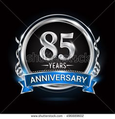 Logo celebrating 85 years anniversary with silver ring and blue ribbon.