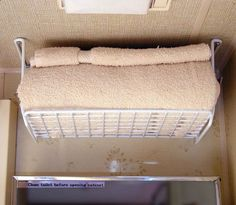 Wire shelf installed upside dawn in trailer bathroom and used as a towel shelf. So many brilliant storage ideas on this site! - mountaincampingzmountaincampingz