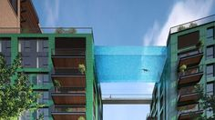 """London's sky pool will let the super-rich swim through the air//Developers in London are building what they claim is the world's first """"sky pool"""" — a 25-meter-long swimming pool suspended 10 stories in the air between two blocks of luxury flats. The transparent pool at Embassy Gardens will be three meters deep with a water depth of 1.2 meters, and will be constructed with the help of aquarium designers using 20-cm-thick glass. The pool will allow residents to swim between the development's…"""
