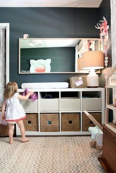A genius space-saving solution for a nursery, these Expedit shelves from Ikea were used as a changing table. For a similar look, try the  Bestå Shelving Unit ($70). Source: House*Tweaking