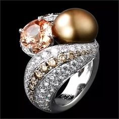Cartier Ring, Solar Landscape – Ring – platinum, one 5.38-carat padparadscha sapphire, one 54.63-grain natural pearl, brown diamonds, brilliants