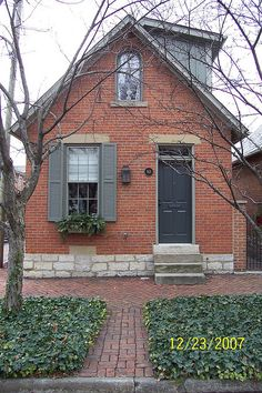 Red brick navy shutters white trim greige siding http - Front door colors for red brick house ...