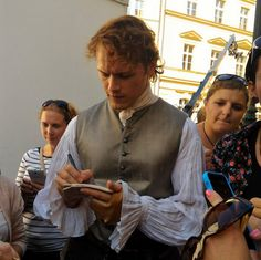 https://www.facebook.com/OutlanderItaly/photos/ms.c.eJw9zckNwEAMAsCOIh~ Sam signing autographs