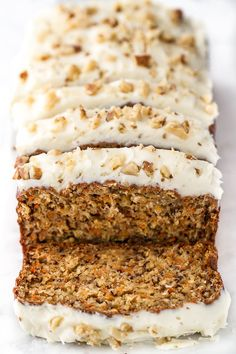 This One Bowl Carrot Cake Banana Bread is made without butter or oil, but so tender and flavourful that you'd never be able to tell it's healthy! Greek yogurt, bananas, and shredded carrots keep it moist, while a sweetened cream cheese frosting makes it feel extra decadent | runningwithspoons.com #recipe #healthy #dessert #spring