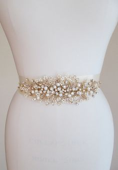 This stunning romantic belt is a real showstopper. Beautifully hand made with fancy Swarovski crystals and cultured freshwater pearls twisted into