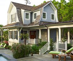 Such a cute house and love the covered porch and functional front yard too -- perfect for parties!