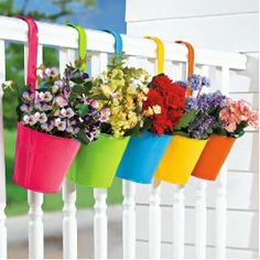 Bright colored hanging planters for Spring!