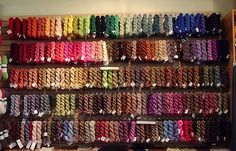 Wall of Koigu ... this on one wall, knitting books on another, I'd be in knitting heaven!