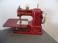 Lovely Vulcan childs sewing machine with lovely 1950s styling. Some scratches to the paint surface and missing the needle and the little screw that