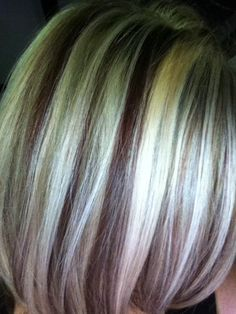 Blonde hair with lowlights. Either drastic like this or subtle lowlights is my next move before all dark!  Just waiting for it to get long long.