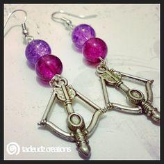 Purple Beaded Cross Bow Arrow Earrings by TadeudzCreations on Etsy