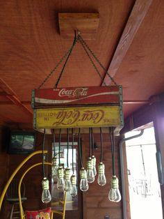 Light made from old coke bottle boxes. Coke Bottle Crafts, Old Coke Crates, Funky Lighting, Lighting Ideas, Coca Cola Kitchen, Vintage Gas Pumps, Bottle Display, Bottle Box, Decoration