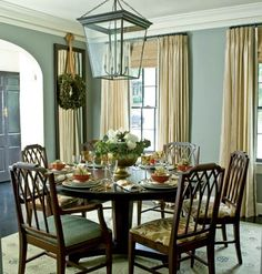 Mirror with wreath pale, steel gray walls in the dining room with floor to ceiling cream shades (and a round dining room table and chairs) Dining Room Blue, Dining Room Colors, Dining Room Design, Dining Rooms, Dining Area, Dining Chairs, Inspiration Design, Dining Room Inspiration, Design Ideas