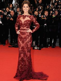 Holy smoke! Cheryl Cole looked sensational as she stepped foot on a soaking wet, red carpet during Cannes Film Festival