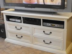 Media storage from an old dresser- really good idea, might do this for upstairs