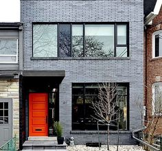 LOVE this gray stained brick and orange door! Grey Brick Houses, Modern Brick House, Townhouse Exterior, Modern Townhouse, Modern Exterior, Exterior Design, Grey Exterior, Brick Colors, Exterior Paint Colors