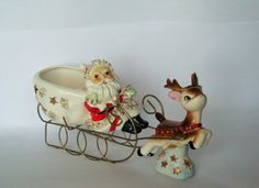 Nice older set...Santa on his sleigh being pulled by a reindeer...porcelain with wire frame...Thames sticker intact...made in Japan...no seen