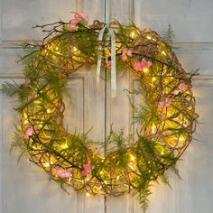"Add a warm glow to indoor spaces with this rustic wreath of rattan vine, each one illuminated by an interwoven strand of twinkling LED lights.- Rattan, iron, PVC, copper, LED lights- Indoor use recommended- May be used outdoors temporarily, or in a sheltered area; keep plug protected from weather- UL approved- Plug-in- Hanging hardware required- 4.9'L lead- Imported4.7""D, 19.7"" diameter"