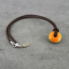Apricot lampwork disc on a brown nappa leather by Unventdeliberte, €18.00