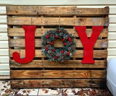 """Love my """"Joy"""" pallet I got to make this afternoon. Letters and paint from Hobby Lobby for less than $15. Wreath from Walmart for $15. Pallet: free. Wha la!"""