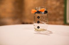 Bow tie mason jar favor for our male guests Photo By robert godridge photography